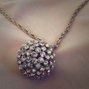 Fab Gold necklace with gold gem ball.