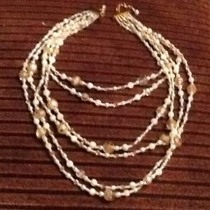 Six strand cream colored and white beaded necklace