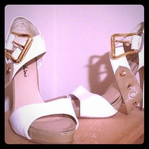 Nice white/tan buckle heels!