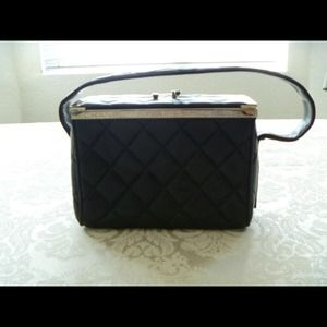 Chanel:  limited edition black lambskin box bag