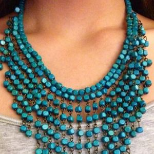 beaded necklace, blue color.