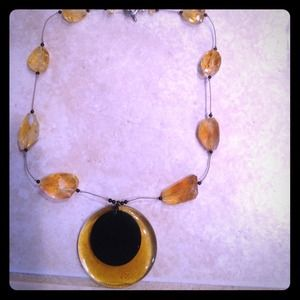 Black and gold glass necklace.