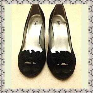 Black suede peep toe heels with ruffle detail
