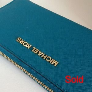 N/AMichael Kors Turquoise zip around wallet