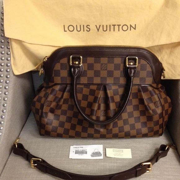 e5066bd532 Louis Vuitton Handbags - HOLD 100% authentic Trevi PM Damier Ebene PM Bag