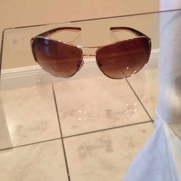 b1d66748b95 Prada Accessories - Prada sunglasses