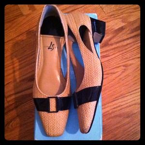 Adorable Woven Heels with Patent Leather Accent.