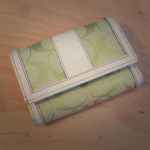 Green and white trifold Coach wallet