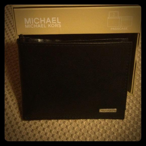 aad2e886e832 Michael Kors men's black passcase wallet in box. M_52ae5414c8ce8515820962af