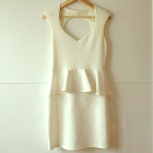 White peplum dress with cutout in the back