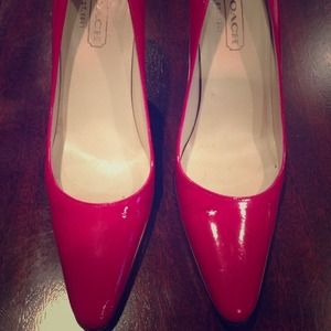Hot pink patent leather Coach pumps