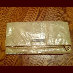 BCBG gold clutch purse