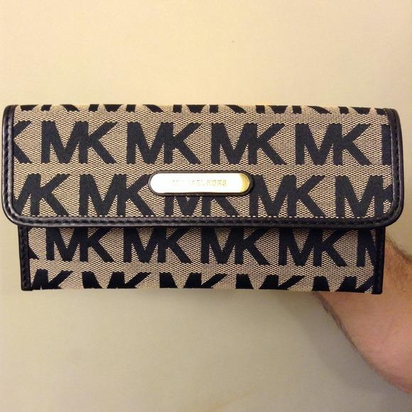 de02d3989b4c Authentic Michael Kors Black Signature Wallet. M_52c81c0e4845e60db41cebe6