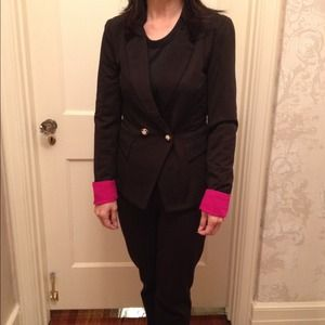 Brand new black blazer with bright pink cuffs.