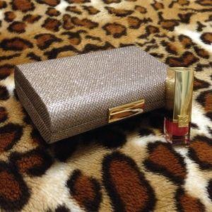 Gold holiday clutch with Estée Lauder lipstick