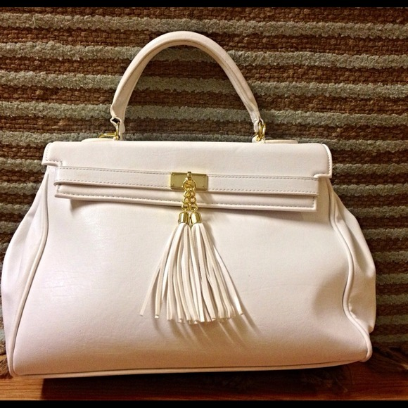 5b3424101e0 ALDO Handbags - RESERVED  ALDO White Leather Satchel Tassel Charm