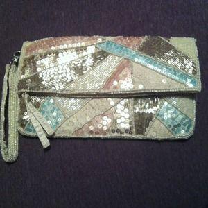 ALDO Handbags - Sequin pastel color aldo clutch!