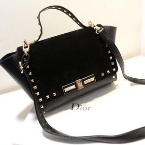 Black metal stud trapeze shoulder bag