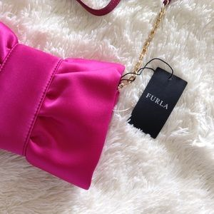 Furla Handbags - Furla pink satin 'Venere' bow clutch