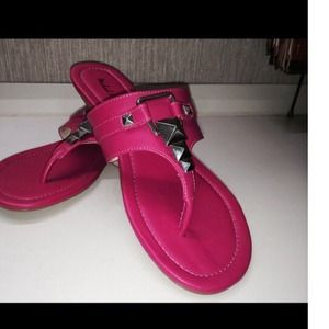 Michael Antonio pink sandals with metal accents.