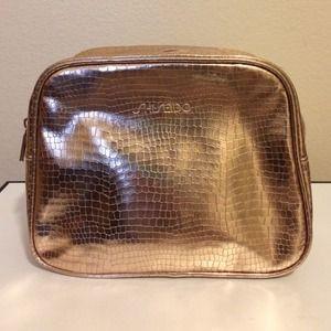 Shiseido Handbags - GOLD Shiseido Cosmetic Makeup Bag