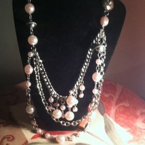 Pink pearl necklace set.