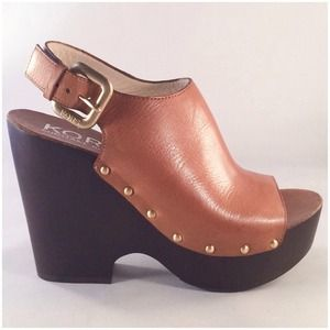 Michael Kors: Scotia dark tan clogs