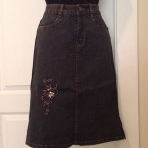 Jean skirt with floral detail.