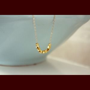 Dainty gold nugget necklace