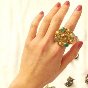 Gold green gemed ring