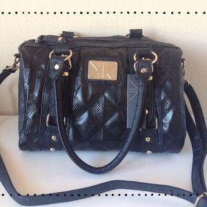 Black Quilted Barrel Bag