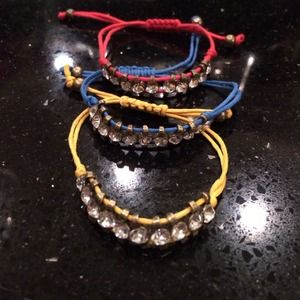 Three rhinestone bracelets