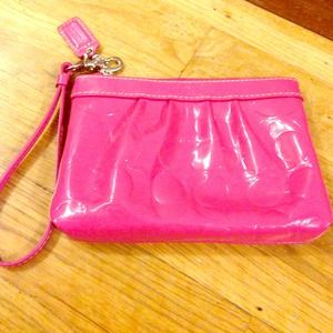 Coach pink patent leather clutch
