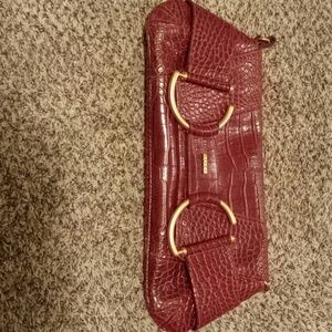 Horsebit red alligator clutch,