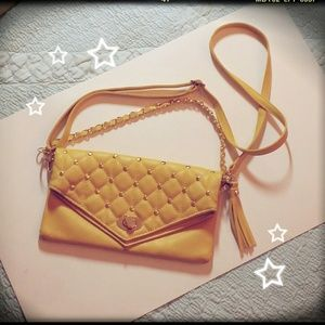 Yellow studded clutch / purse with a tassle