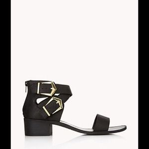 Faux leather black sandals with buckled straps