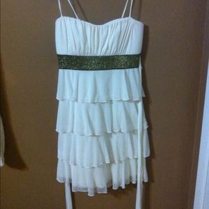 White silky dress with gold sash