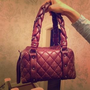 Chanel distressed lambskin quilted maroon bag.