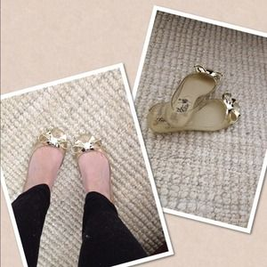 Gold bow toe flats