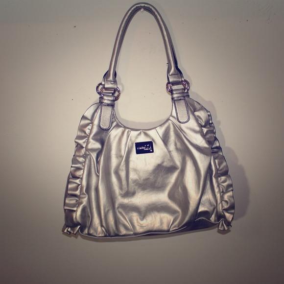 2acc6ad8e210 Handbags - Silver Ruffle Nine   Co Purse (NWOT)