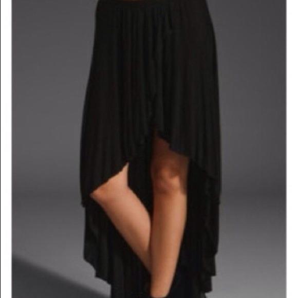 009e65d43a Brandy Melville short front long back skirt. M_530bef1b5d5f4e22fe1f1851