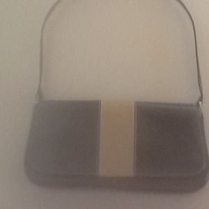 Black handbag with beige stripe