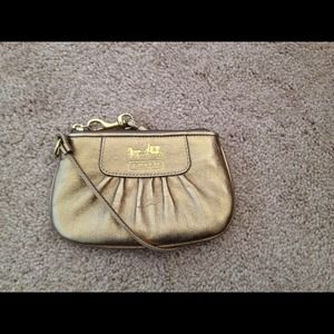 Coach Madison metallic gold wristlet/clutch
