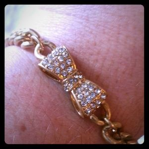 Gold bow bracelet with crystals