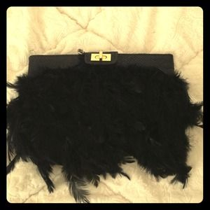 Black feather clutch with gold clasp