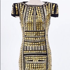 Perfect gold studded party dress. Has stretch!