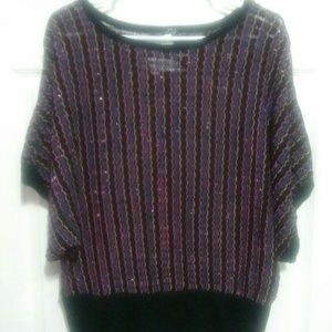 Large shiny and multicolored sweater