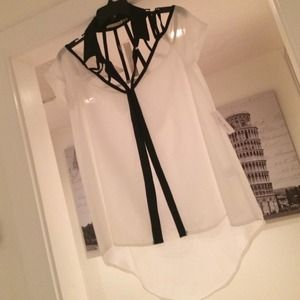 White party shirt with black collar