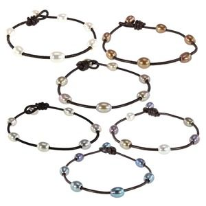 Jewelry - Leather and pearl bracelets.