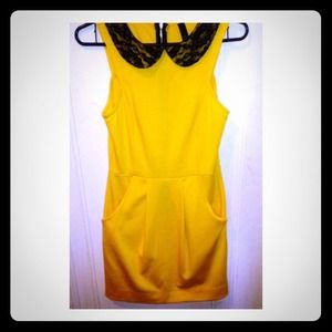 Fitted A-line yellow dress with black lace collar